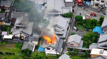 TAKATSUKI, JAPAN - JUNE 18: (CHINA OUT, SOUTH KOREA OUT) In this aerial image, fire breaks out at a house after the magnitude 6.1 earthquake on June 18, 2018 in Takatsuki, Osaka, Japan. A powerful earthquake struck Osaka and neighbouring prefectures, killing at least three people and disrupting morning train services and knocking out power in a widespread area. The quake, which hit at 7:58 am, registered a lower 6 on the Japanese seismic intensity scale of 7 in northern Osaka Prefecture and an upper 5 in southern Kyoto Prefecture, according to the Meteorological Agency. (Photo by The Asahi Shimbun via Getty Images)