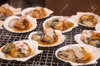 Seafood grill - street food in Tsukiji fish market, Tokyo, Japan.